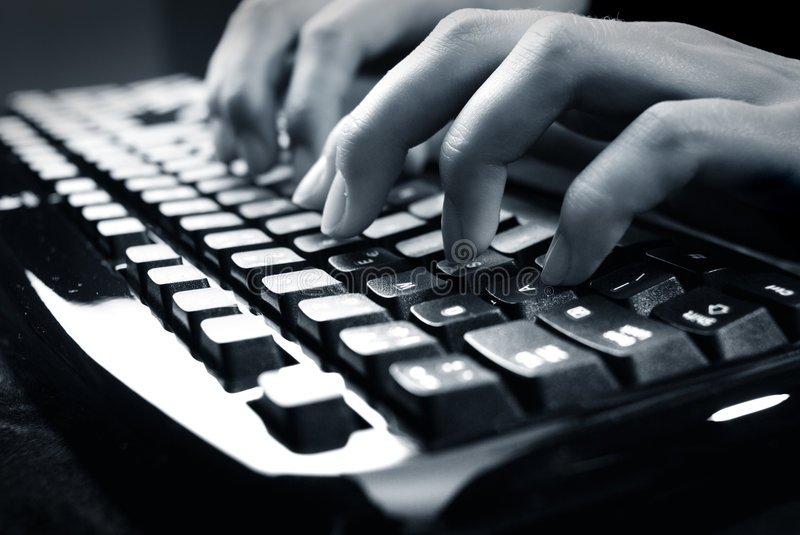 Fingers on keyboard. Writing fingers on PC keyboard royalty free stock image
