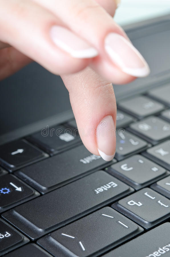 Fingers over the keyboard. Women's fingers over the keyboard laptop stock images