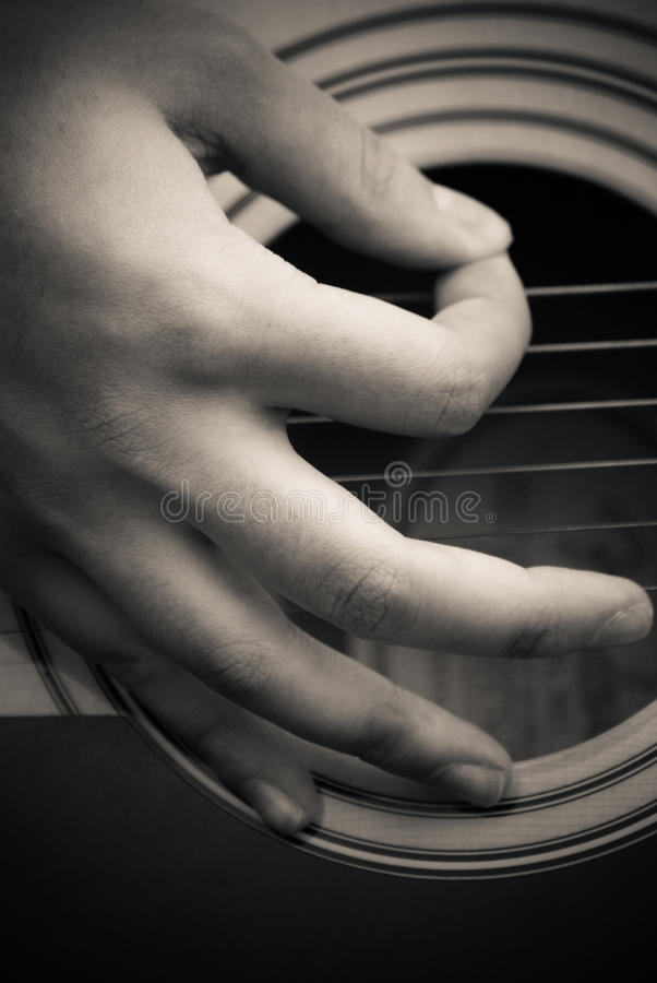 Download Fingers picking guitar stock image. Image of hand, guitar - 16410149
