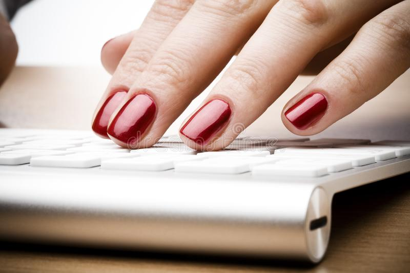 Fingers with red nail stock images
