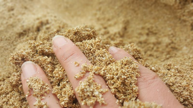 Fingers in Sand stock image