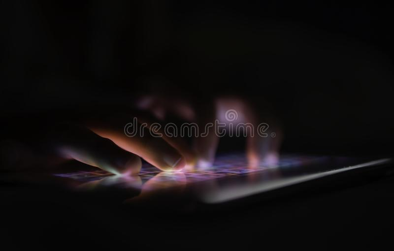The fingers of small children with tablets, children with a finger display screen Application for children Preschoolers play games royalty free stock photography
