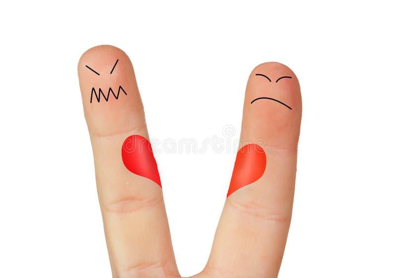 Fingers symbolizing the separation of a couple. Isolated on white background stock image