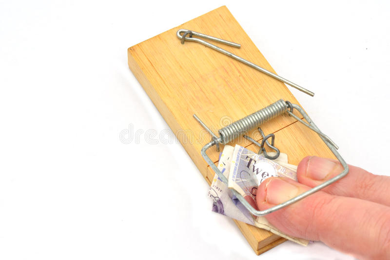 Fingers trapped in mousetrap royalty free stock photo