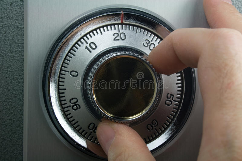 Fingers Turning Safe Dial stock photos