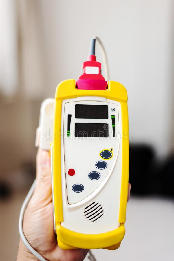 Fingertip Pulse Oximeter on finger of patient. In hospital royalty free stock photos