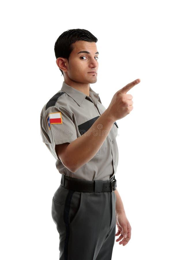 fingertjänsteman som pekar säkerhetswardenen arkivbilder