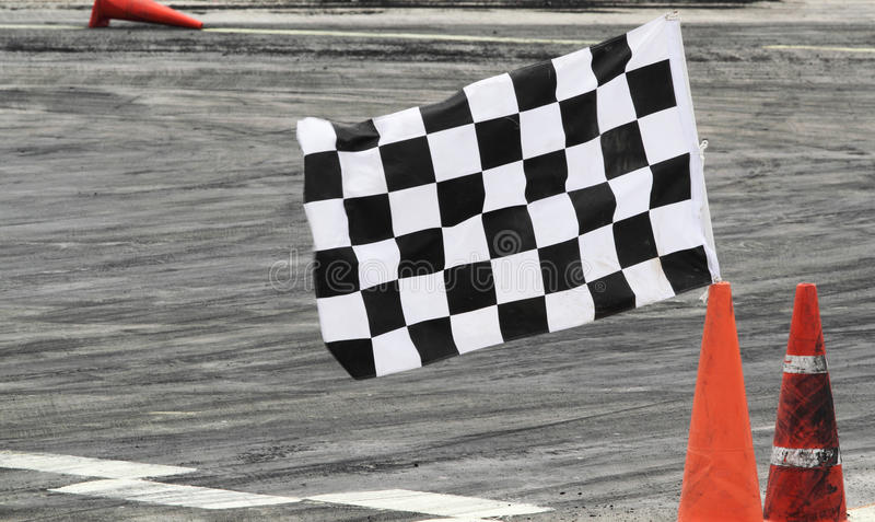 Finish flag. On track in racing car stock image