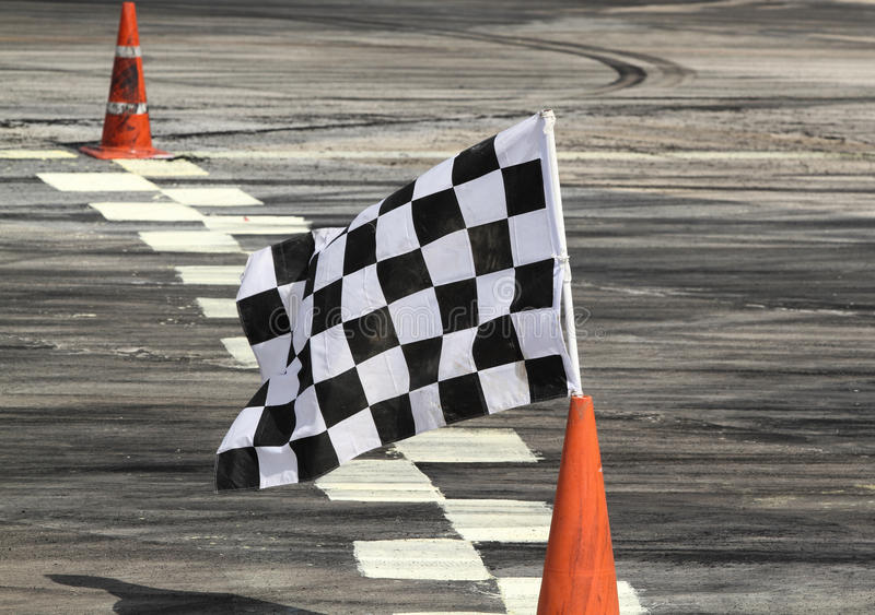 Finish flag. On track in racing car royalty free stock photo