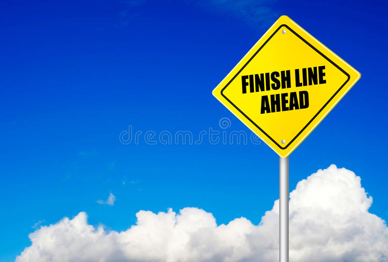 Finish line ahead message on road sign royalty free stock photo