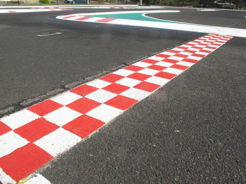 Finish line in finish racetrack, red and white color royalty free stock image