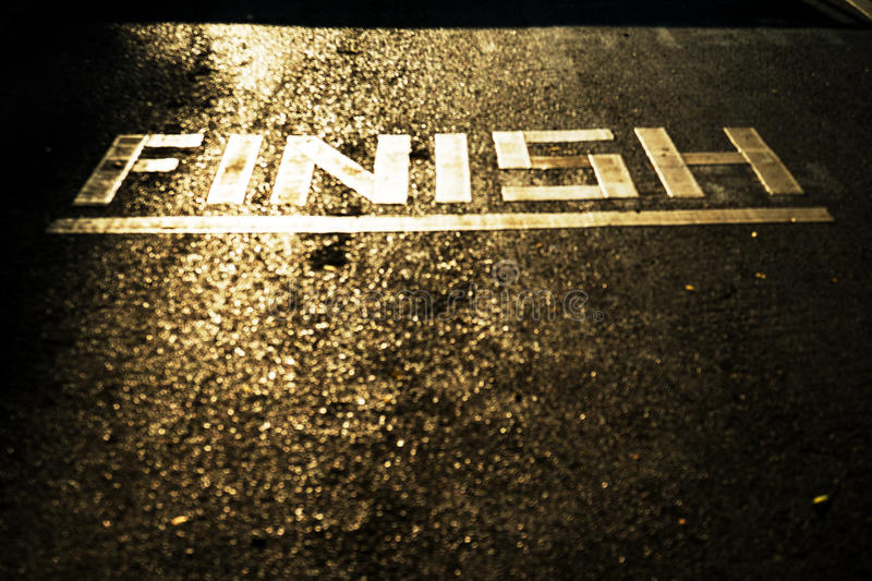 Finish line on running track stock photos