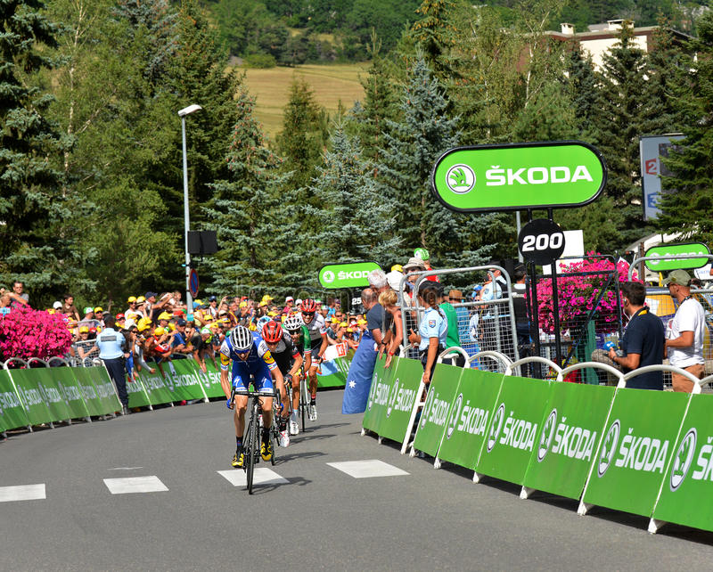 Finish of the Stage 17 in Serre Chevalier ,Tour de France 2017. SERRE-CHEVALIER , FRANCE - JULY 19, 2017. Finish of the Stage 17 in Serre Chevalier , route La royalty free stock image