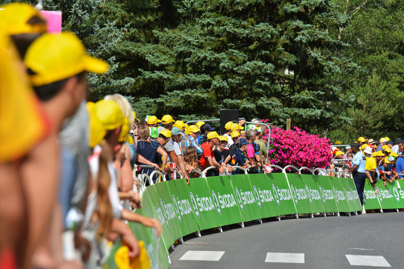 Finish of th Stage 17 in Serre Chevalier ,Tour de France 2017. SERRE-CHEVALIER , FRANCE - JULY 19, 2017. Crowd of people at the Finish of the Stage 17 in Serre stock photography