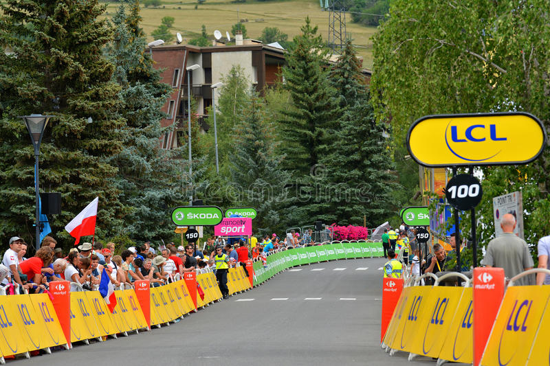 Finish of th Stage 17 in Serre Chevalier ,Tour de France 2017. SERRE-CHEVALIER , FRANCE - JULY 19, 2017. Crowd of people at the Finish of the Stage 17 in Serre royalty free stock images