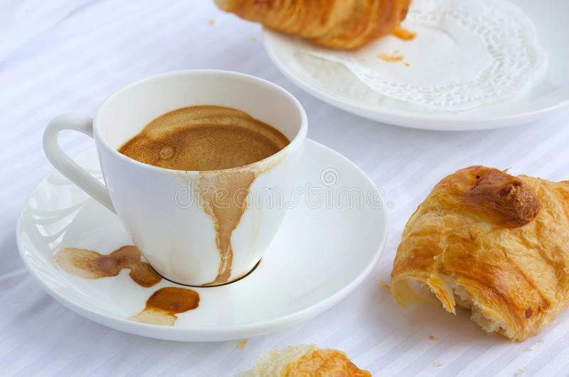 Finished breakfast on a white table cloth. Closeup stock images