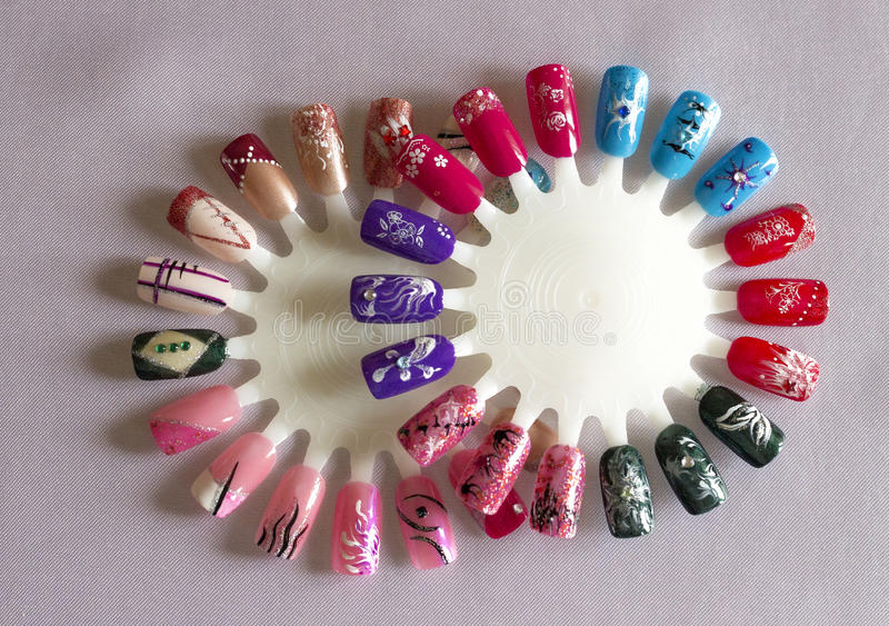 Finished plastic nails. Different motives stock photo