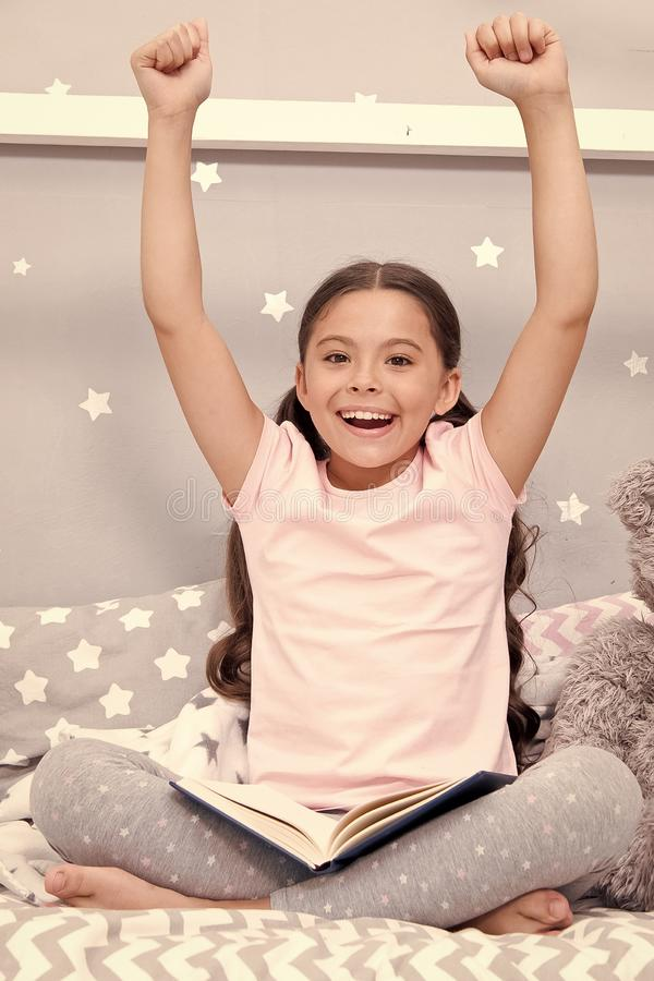 Finished reading book. Girl child sit bed with teddy bear finished reading book. Kid ready to go to bed. Finally. Finished that book. Girl kid long hair cute stock photography