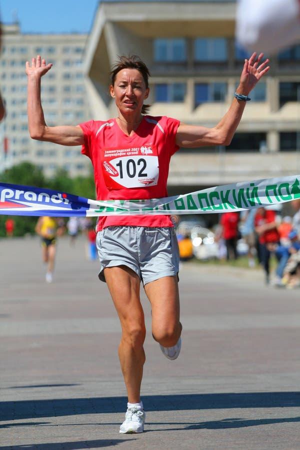 Finishing run woman stock image