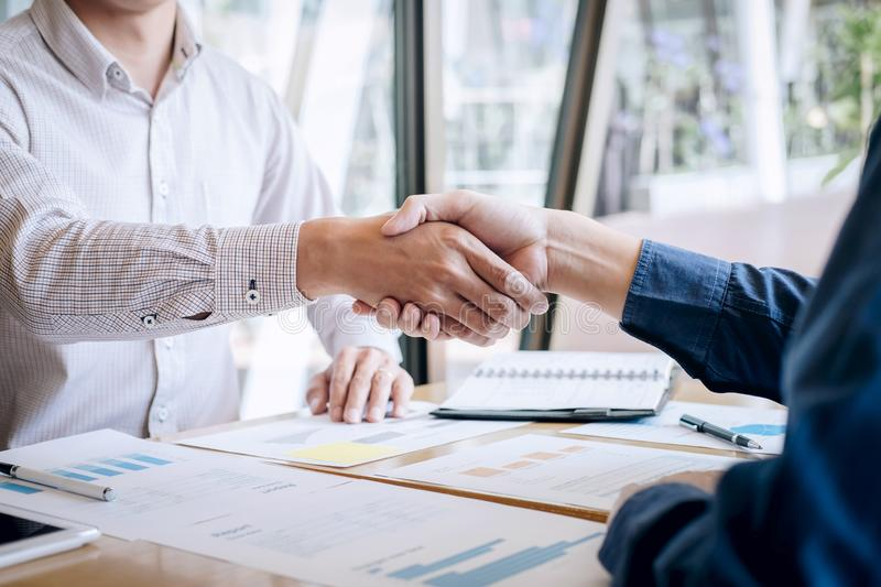 Finishing up a conversation after collaboration, handshake of two business people after contract agreement to become a partner,. Collaborative teamwork stock photo