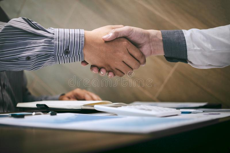 Finishing up a conversation after collaboration, handshake of two business people after contract agreement to become a partner,. Collaborative teamwork stock photos