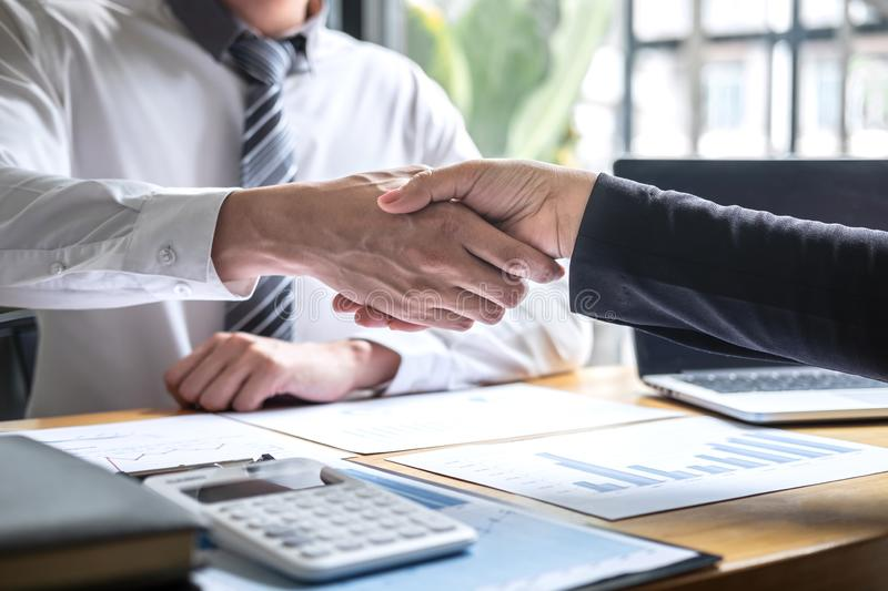 Finishing up a conversation after collaboration, handshake of two business people after contract agreement to become a partner,. Collaborative teamwork royalty free stock photo