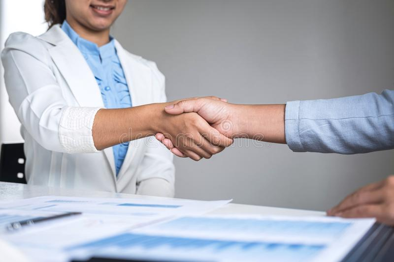 Finishing up a conversation after collaboration, handshake of two business woman leader after successful contract agreement to stock photo