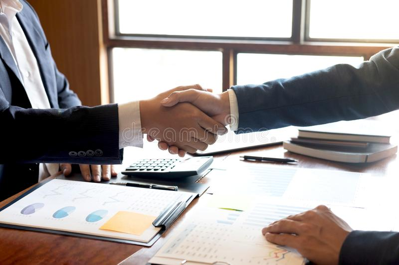 Finishing up a discussion on meeting after collaboration, handshake of two business people after contract agreement to. Congratulation become a partner royalty free stock image