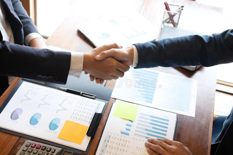 Finishing up a discussion on meeting after collaboration, handshake of two business people after contract agreement to. Congratulation become a partner royalty free stock photo