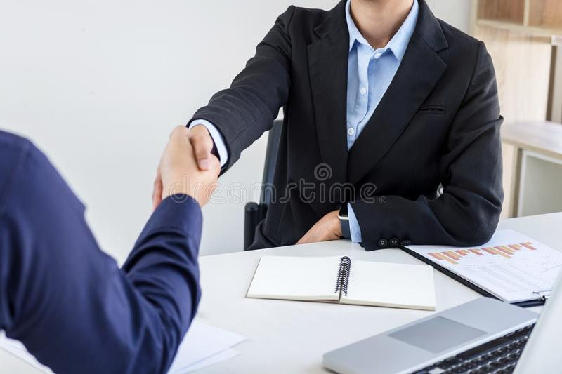 Finishing up a meeting, Business handshake after discussing good. Deal of Trading contract for both companies and gesturing people connection deal, Meeting and royalty free stock photo