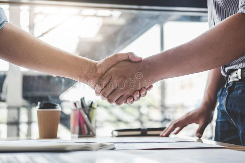 Finishing up a meeting, Business handshake after discussing good deal of Trading contract for both companies and gesturing people. Connection deal, Meeting and stock image