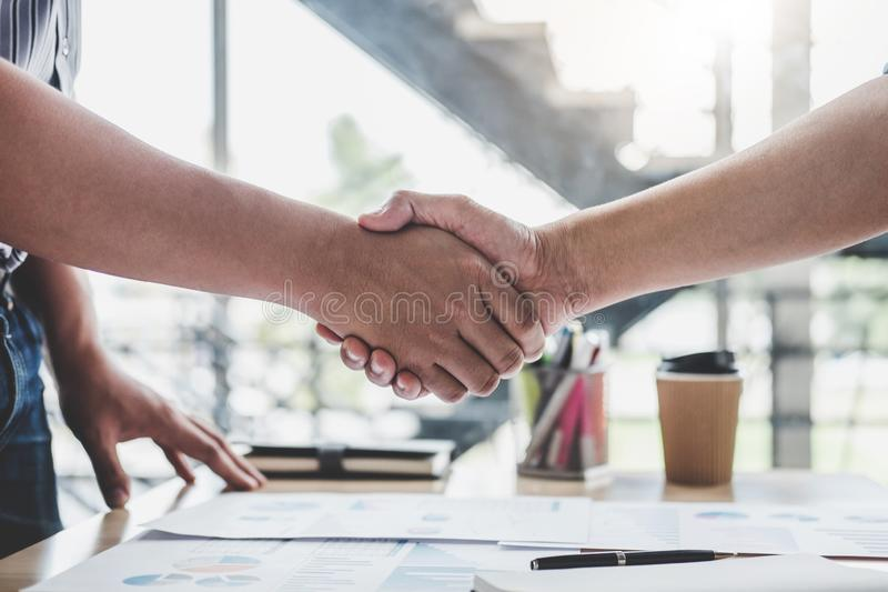 Finishing up a meeting, Business handshake after discussing good deal of Trading contract for both companies and gesturing people. Connection deal, Meeting and royalty free stock photography