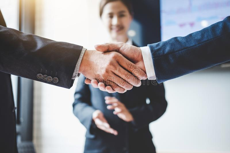 Finishing up a meeting, Business handshake after discussing good. Deal of Trading to sign agreement and become a business partner, contract for both companies stock photo
