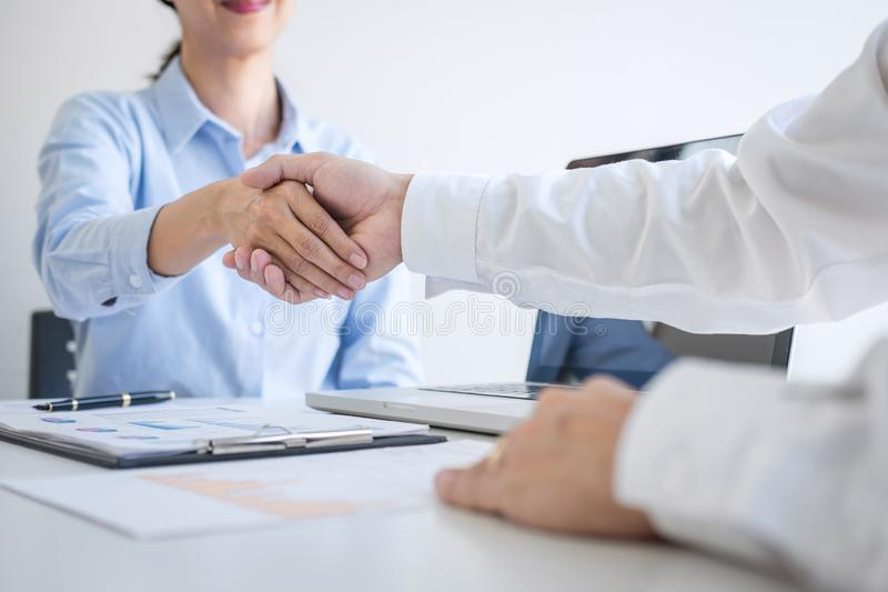 Finishing up a meeting, Business handshake after discussing good deal of Trading to sign agreement and become a business partner,. Contract for both companies royalty free stock image