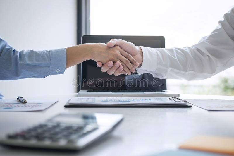 Finishing up a meeting, Business handshake after discussing good deal of Trading to sign agreement and become a business partner,. Contract for both companies royalty free stock photo