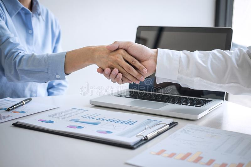 Finishing up a meeting, Business handshake after discussing good deal of Trading to sign agreement and become a business partner,. Contract for both companies stock photography