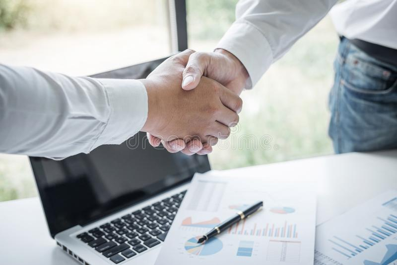 Finishing up a meeting, Business handshake after discussing good deal of Trading to sign agreement and become a business partner,. Contract for both companies royalty free stock photos