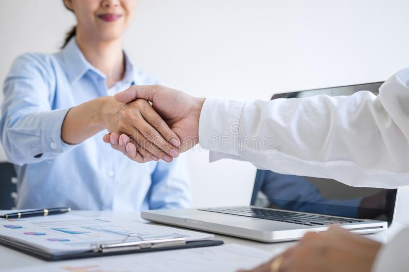 Finishing up a meeting, Business handshake after discussing good deal of Trading to sign agreement and become a business partner,. Contract for both companies royalty free stock photography