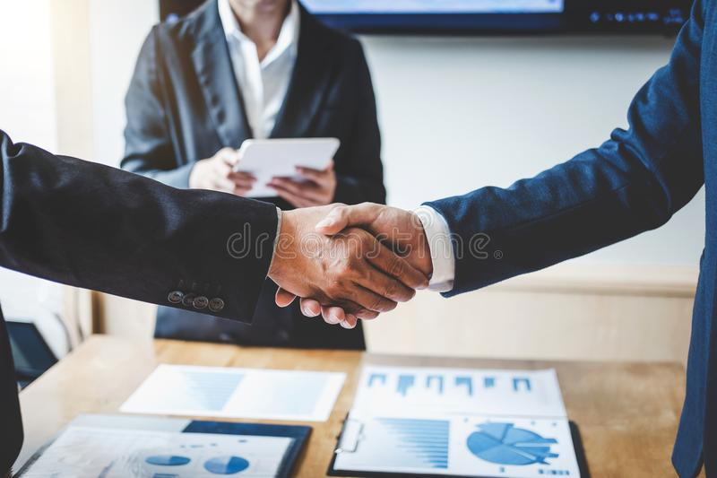 Finishing up a meeting, Business handshake after discussing good. Deal of Trading to sign agreement and become a business partner, contract for both companies royalty free stock photo