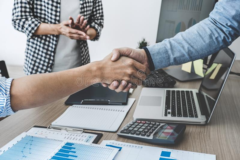 Finishing up a meeting, Business shaking hands after discussing good deal of Trading to sign agreement and become a partner,. Contract for both companies royalty free stock images