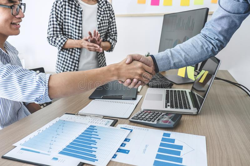 Finishing up a meeting, Business shaking hands after discussing good deal of Trading to sign agreement and become a partner,. Contract for both companies royalty free stock photography
