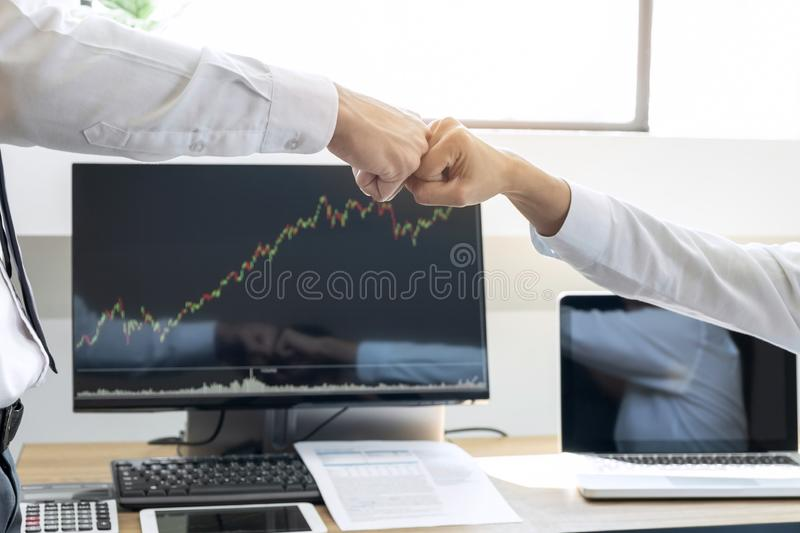 Finishing up a meeting, giving first bump of hand`s two happy bu stock photography