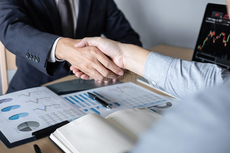 Finishing up a meeting, Handshake of two executive business people after contract agreement to become a partner, collaborative royalty free stock image