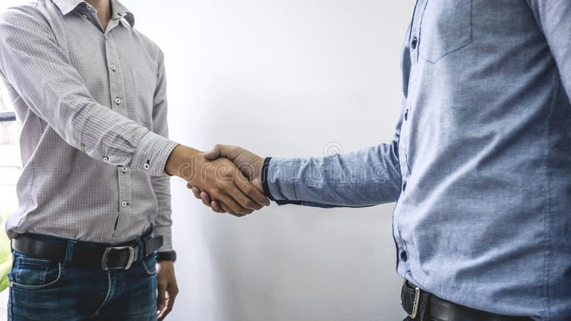 Finishing up a meeting, handshake of two happy business people after contract agreement to become a partner, collaborative. Teamwork stock image
