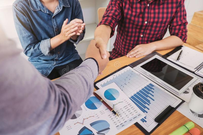 Finishing up a meeting, handshake of two happy business people after contract agreement to become a partner, collaborative royalty free stock photography