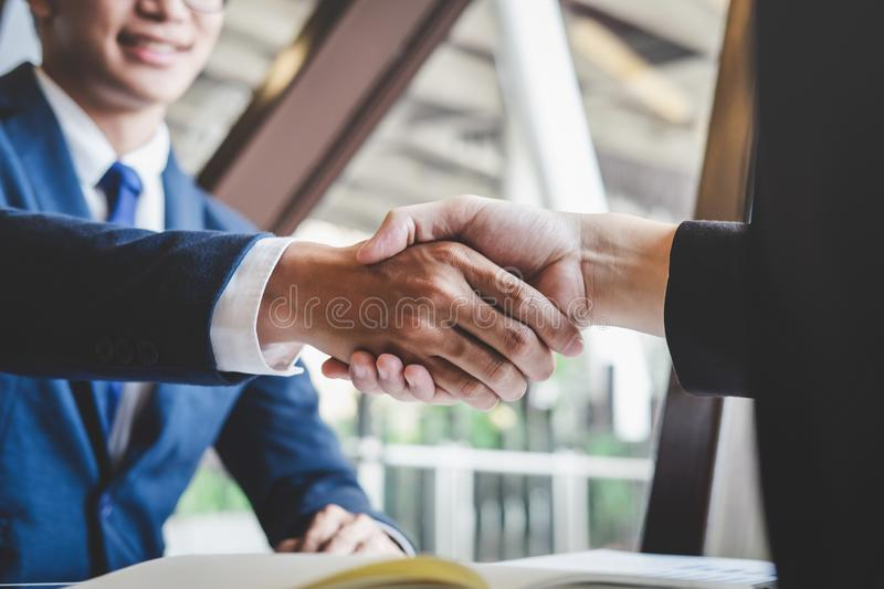 Finishing up a meeting, handshake of two happy business people after contract agreement to become a partner, collaborative. Teamwork royalty free stock images
