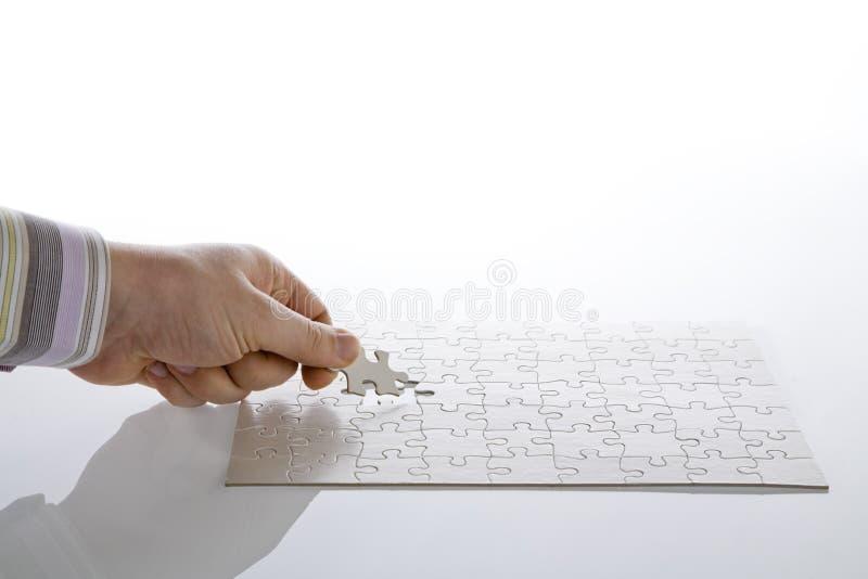 Finishing white puzzle royalty free stock image