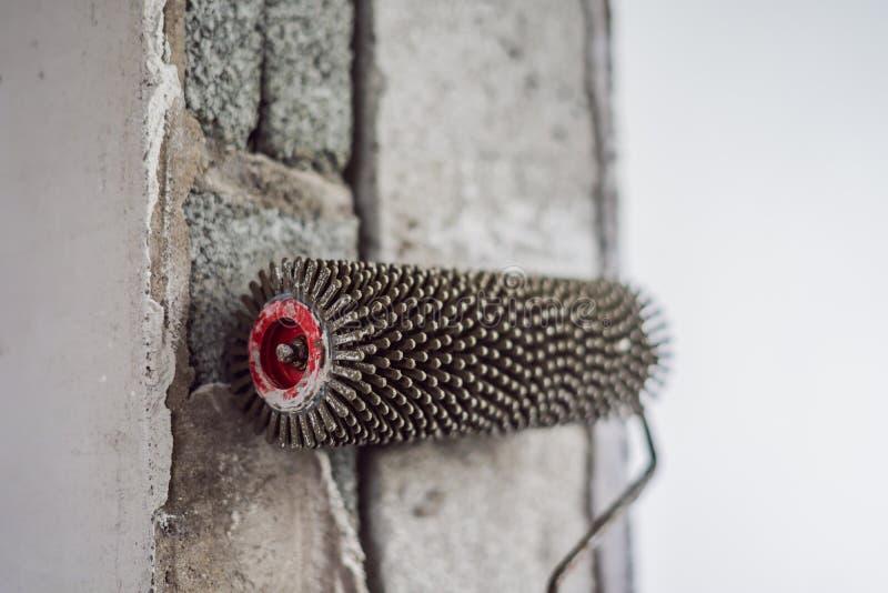 Finishing works - Needle roller for bulk floor royalty free stock photography