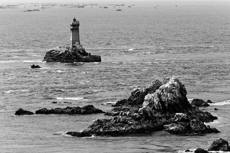 Finisterre islets with a lighthouse, Bretagne, France. A series of islets, with a lighthouse built on one of them. Cape Finisterre, Bretagne, France stock photos