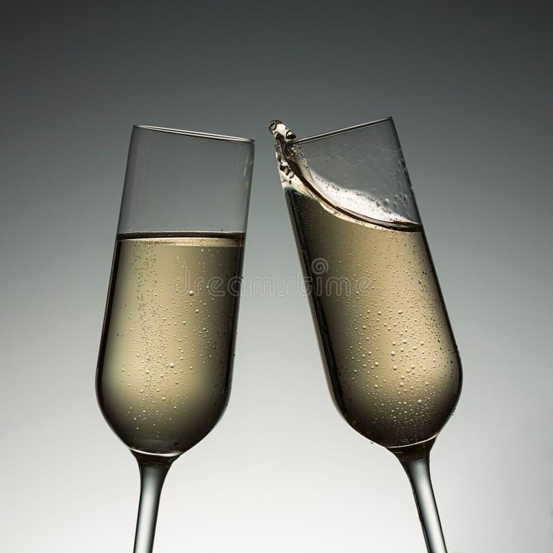 Finkaexponeringsglas med champagnefärgstänk royaltyfri bild